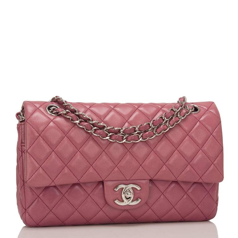 Chanel Medium Classic Double Flap bag of Rose Fonce (dark rose pink) quilted lambskin leather and silver tone hardware.  The bag features a front flap with signature CC turnlock closure, a half moon back pocket and an adjustable interwoven silver