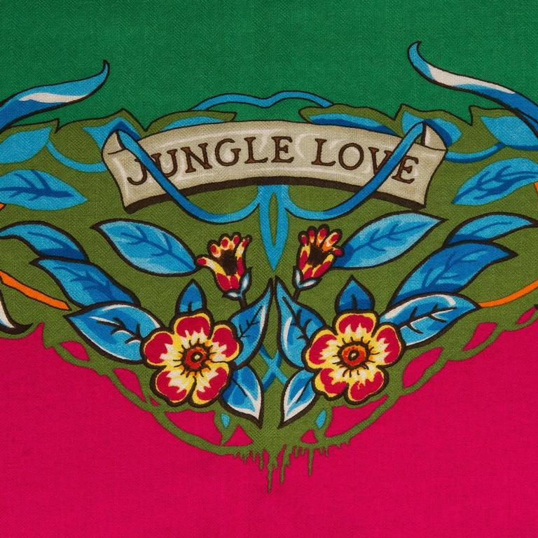 """Hermes """"Jungle Love"""" cashmere and silk shawl 140cm designed by Robert Dallet in a green colorway.  Fabric: 65% cashmere, 35% silk  Origin: France  Condition: Pristine, never worn  Accompanied by: Box, caretag, and ribbon  Size: 140cm (55"""""""