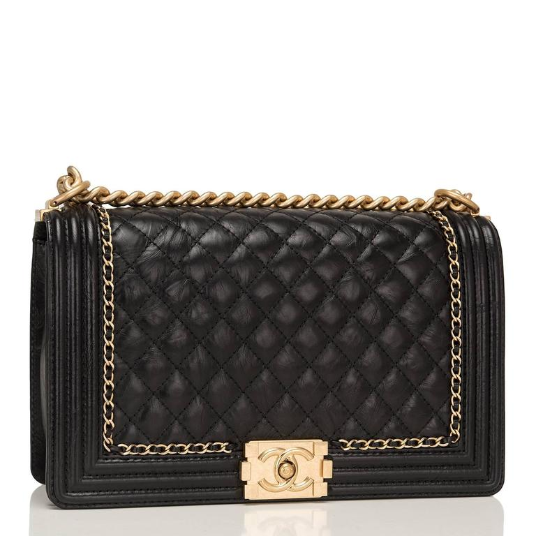 """Chanel New Medium """"Jacket"""" Boy bag of black aged calfskin leather with aged gold hardware.  This limited edition bag features a full front flap with the Le Boy CC push lock closure and an aged gold chain link and black leather padded"""