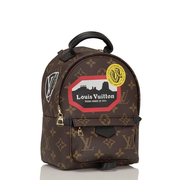 "Louis Vuitton ""World Tour"" Monogram Palm Springs Backpack Mini designed by Nicholas Ghesquiere of coated canvas with golden brass hardware and accented by Louis Vuitton patches.