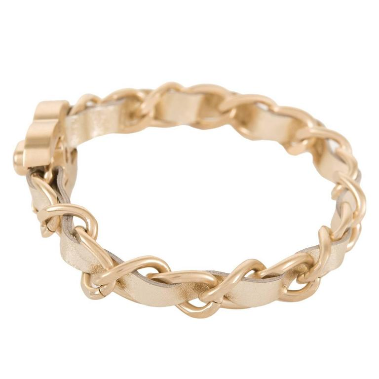 Chanel Gold Interwoven Leather And Chain CC Turnlock Bracelet In As New Condition For Sale In New York, NY