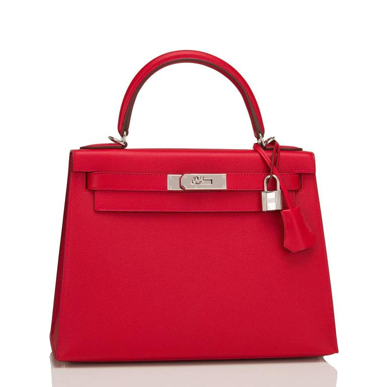 Hermes Rouge Casaque Sellier Kelly 28cm of epsom leather with palladium hardware.  This Kelly Sellier has tonal stitching, a front toggle closure, a clochette with lock and two keys, a single rolled handle and an optional shoulder strap.  The