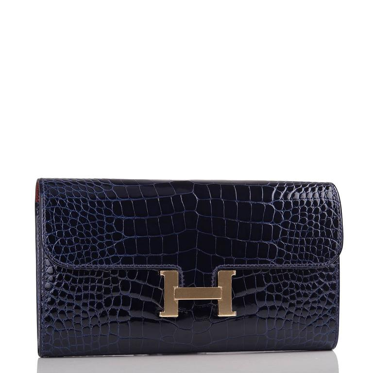 "Hermes Constance Long Clutch of Blue Marine alligator leather with rose gold hardware.  This clutch, which can also be worn as a wallet, has tonal stitching, a metal ""H"" snap lock closure and a rear exterior pocket.  The interior is lined"