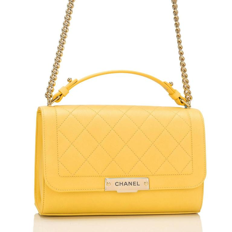 Chanel Medium Label Click Flap bag of quilted and smooth yellow grained calfskin leather and gold tone hardware.  This limited edition Chanel bag, from the 2017 cruise collection, features a front flap with push-lock closure, Chanel gold tone