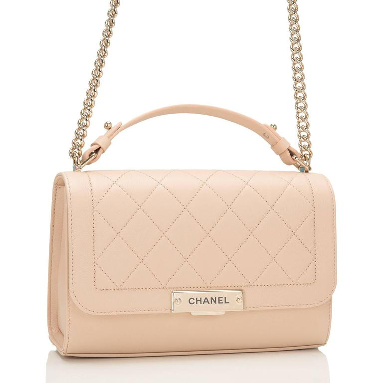 """Chanel Medium Label Click Flap bag of quilted and smooth light """"nude"""" beige grained calfskin leather and gold tone hardware.  This limited edition Chanel bag, from the 2017 cruise collection, features a front flap with push-lock closure, Chanel"""