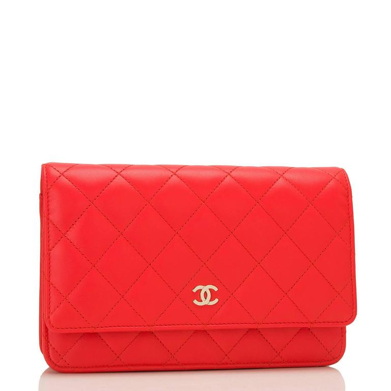Chanel Classic Wallet On Chain (WOC) of red lambskin leather with gold tone hardware.