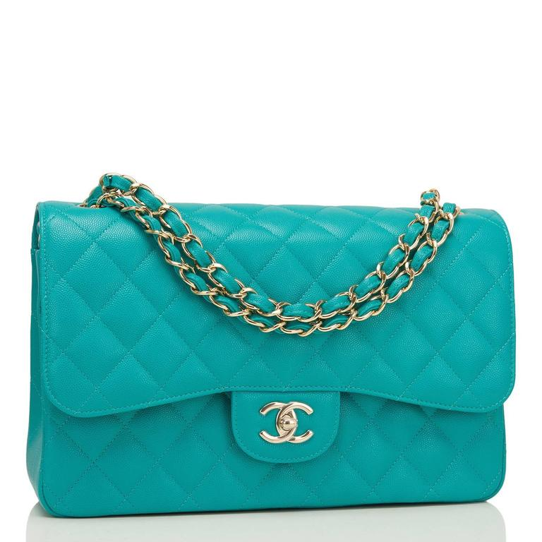 Chanel Jumbo Classic double flap bag of turquoise quilted caviar leather and accented with light gold tone hardware.  The bag features a front flap with signature CC turnlock closure, a half moon back pocket, and an adjustable interwoven light gold