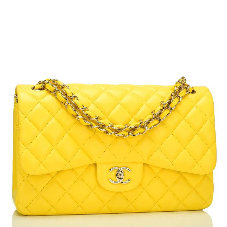 Chanel Jumbo Classic double flap bag of yellow quilted lambskin leather and accented with gold tone hardware.  The bag features a front flap with signature CC turnlock closure, a half moon back pocket, and an adjustable interwoven gold tone chain