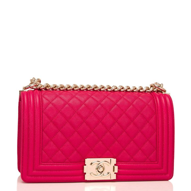 Chanel Old Medium Boy bag of fuchsia quilted caviar leather and light gold tone hardware.  This Chanel bag is in the classic Boy style with a full front flap with the Boy signature CC push lock closure, smooth leather trim and light gold tone chain
