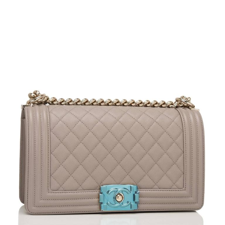 Chanel Old Medium Boy bag of taupe (dark beige) quilted caviar leather and light gold tone hardware.  This Chanel bag is in the classic Boy style with a full front flap with the Boy signature CC push lock closure, smooth leather trim and gold tone