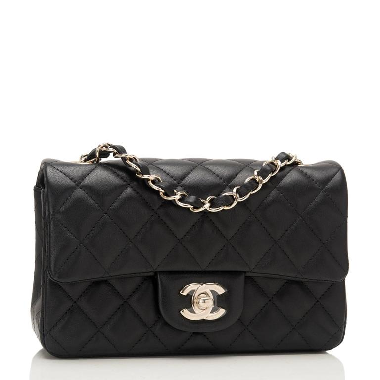 Chanel Rectangular Mini Classic flap bag of black lambskin leather with gold tone hardware.  This bag has a front flap with signature CC turnlock closure, rear half moon pocket and single interwoven black leather and gold tone chain link