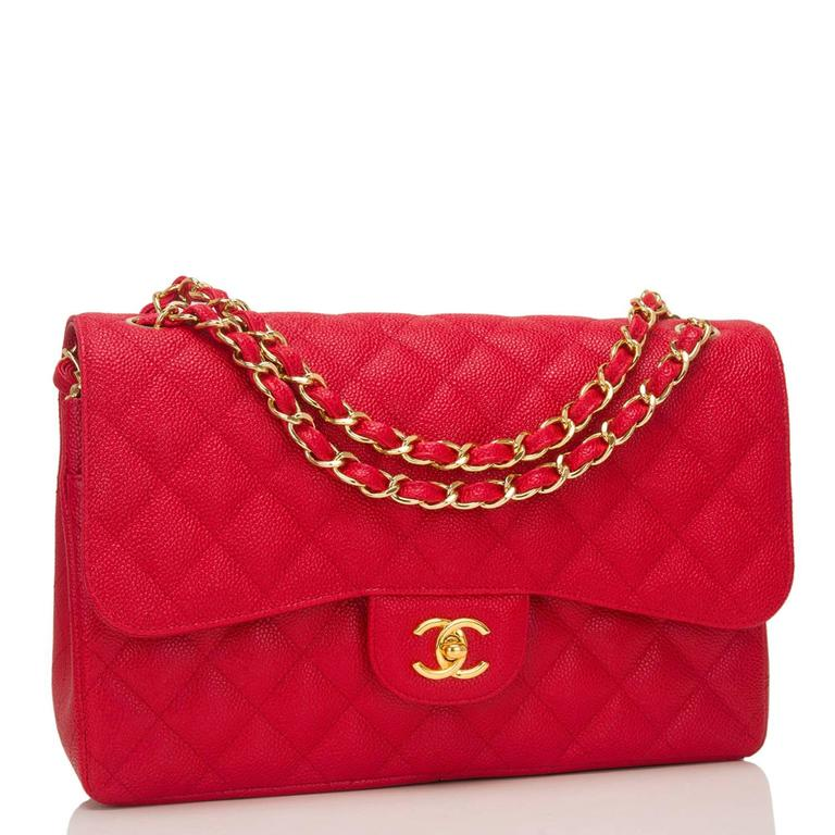 Chanel Jumbo Classic double flap bag of red caviar leather with gold tone hardware.  This bag features a front flap with signature CC turnlock closure, a half moon back pocket, and an adjustable interwoven gold tone chain link and dark red leather