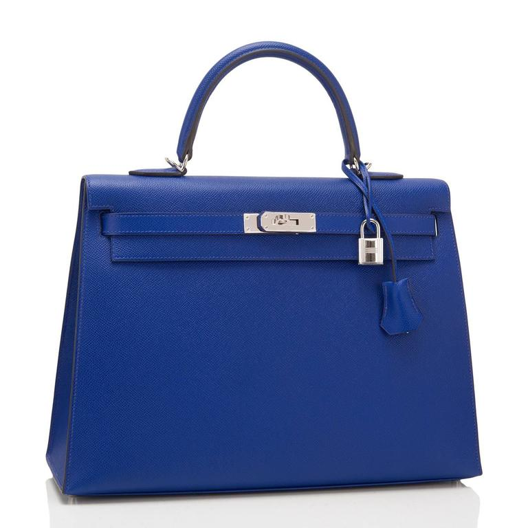 Hermes Blue Electric Kelly 35cm of epsom leather with palladium hardware.  This Kelly, in the sellier style, has tonal stitching, a front toggle closure, a clochette with lock and two keys, a single rolled handle, and a removable shoulder