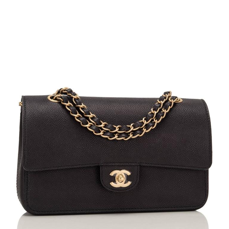 Chanel Medium Classic double flap bag of black caviar leather with gold tone hardware.  This bag features a front flap with signature CC turnlock closure, a half moon back pocket, and an adjustable interwoven gold tone chain link with black leather
