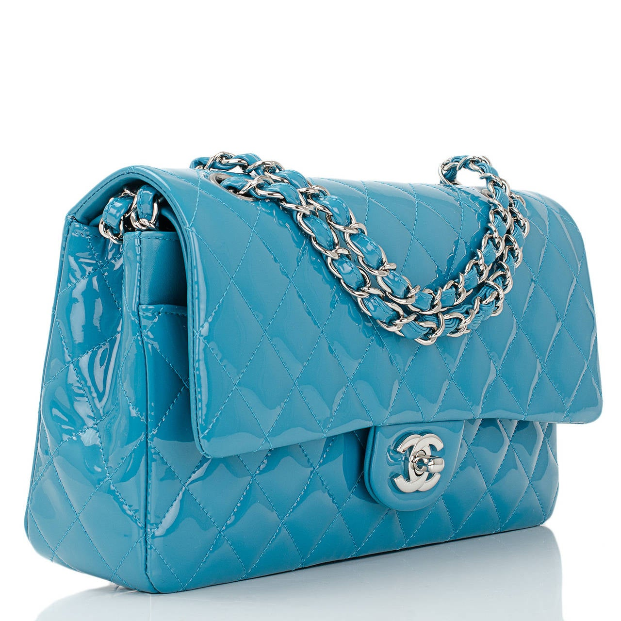 Chanel Medium Classic double flap bag of turquoise quilted patent leather with silver ton hardware features a front flap with signature CC turnlock closure, half moon back pocket and an adjustable interwoven silver tone chain link and turquoise