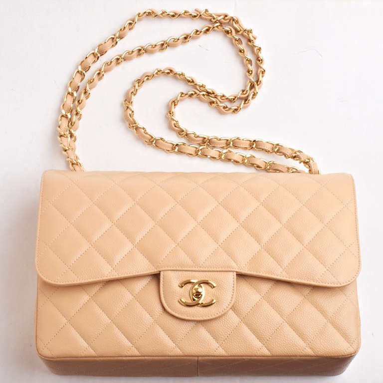 Chanel beige Jumbo Classic 2.55 double flap bag of quilted caviar leather with gold tone hardware.  Named 2.55 to honor the bag's creation in February 1955, the iconic Chanel bag was a modification of the bag Coco Chanel originally designed in
