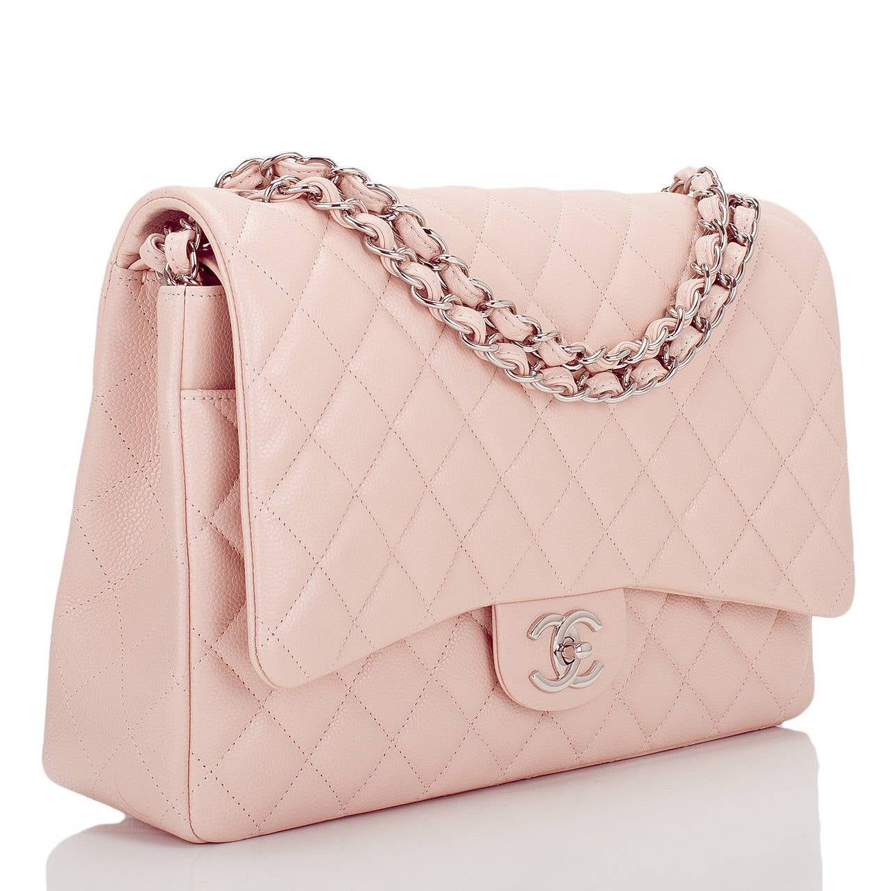 This limited edition Chanel Maxi Classic double flap bag of light pink quilted caviar leather features a front flap with signature CC turnlock closure, half moon back pocket and an adjustable interwoven silver tone chain link and pink leather