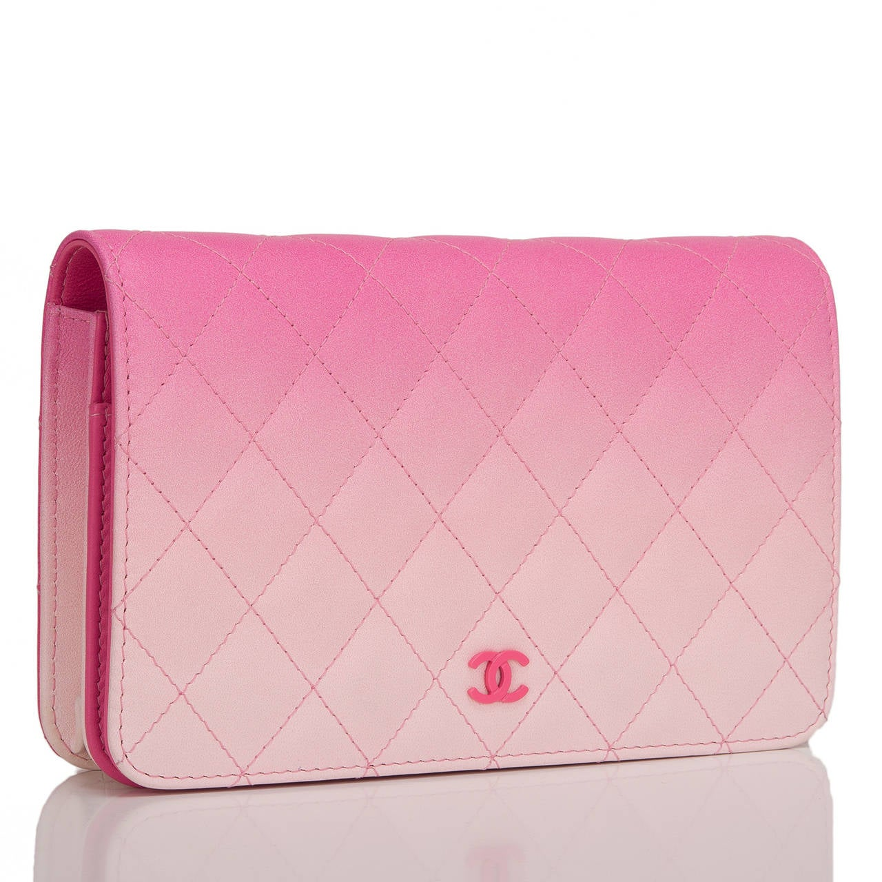 This pink Chanel Wallet On Chain (WOC) style is exceptional in that it features pink ombre lambskin and pink CC detail. The bag is made of signature Chanel quilting, silver tone hardware front flap with CC charm and hidden snap closure, expandable