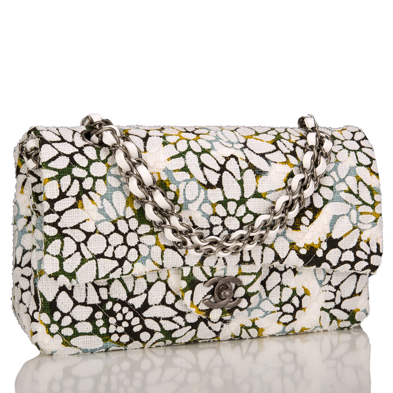 Chanel Medium Classic Double flap bag of multicolor floral textured cotton accented by white leather and aged ruthenium hardware.  This limited edition bag features a front flap with signature CC turnlock closure, half moon back pocket, and an