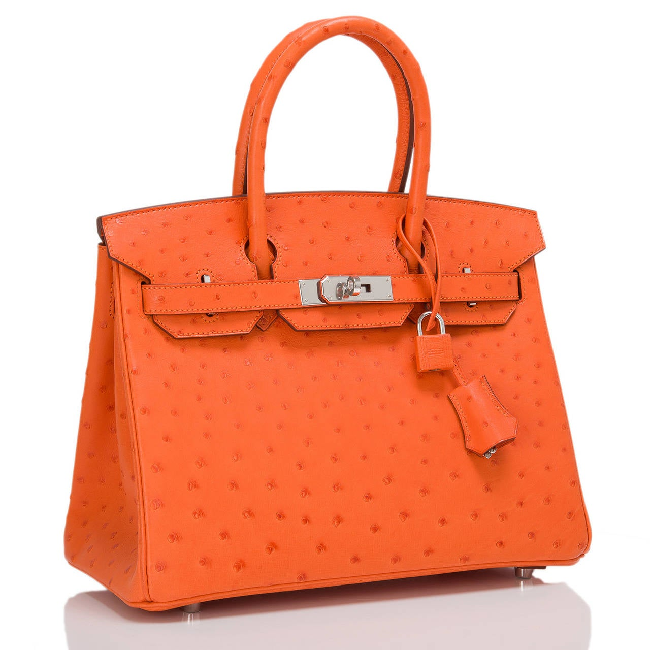 Hermes Tangerine 30cm in Ostrich with palladium hardware.  This Birkin features tonal stitching, front toggle closure, clochette with lock and two keys, and double rolled handles. The interior is lined in Tangerine chevre with one zip pocket with