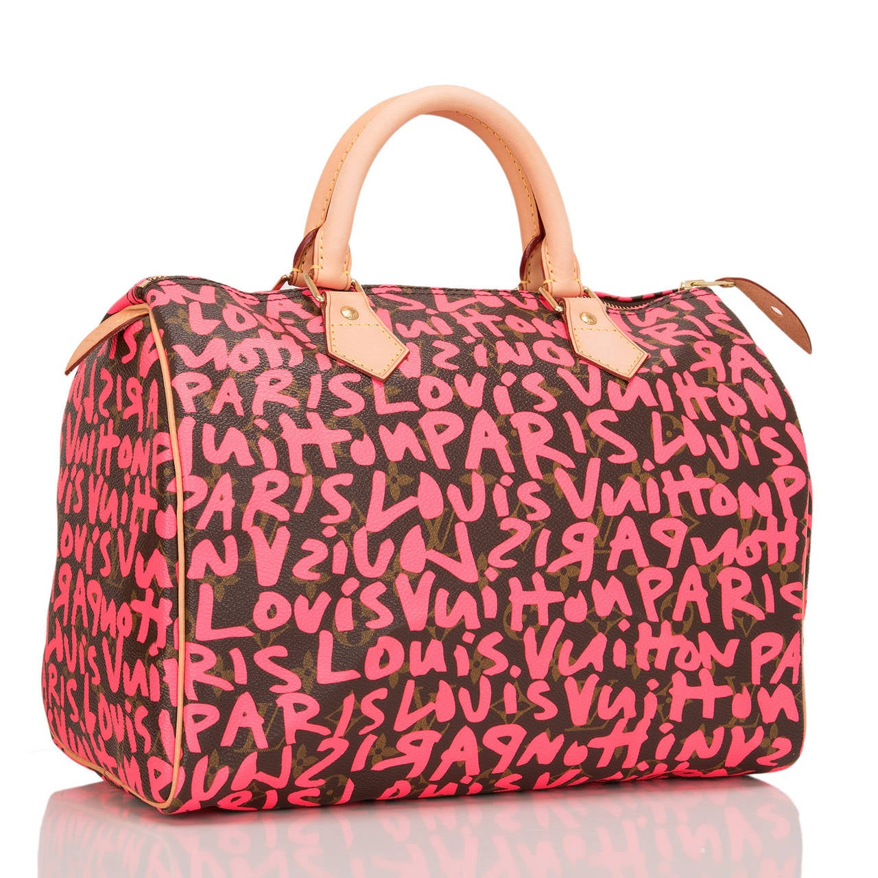 """Louis Vuitton limited edition Stephen Sprouse Monogram Graffiti Speedy 30 of coated canvas with all over """"Louis Vuitton Paris"""" in neon fuchsia pink.  This bag features bright pink lettering silk screened over Louis Vuitton classic Monogram"""