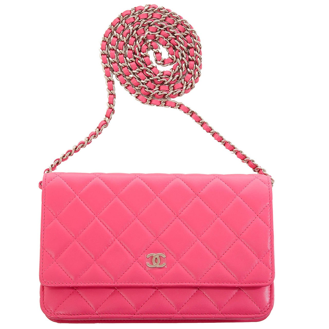 Chanel fuchsia pink Classic Wallet On Chain (WOC) of quilted lambskin leather and silver tone hardware.  The Wallet On Chain (WOC) is one of the most desired Chanel accessories. Its great styling, versatility and attractive price point makes it a