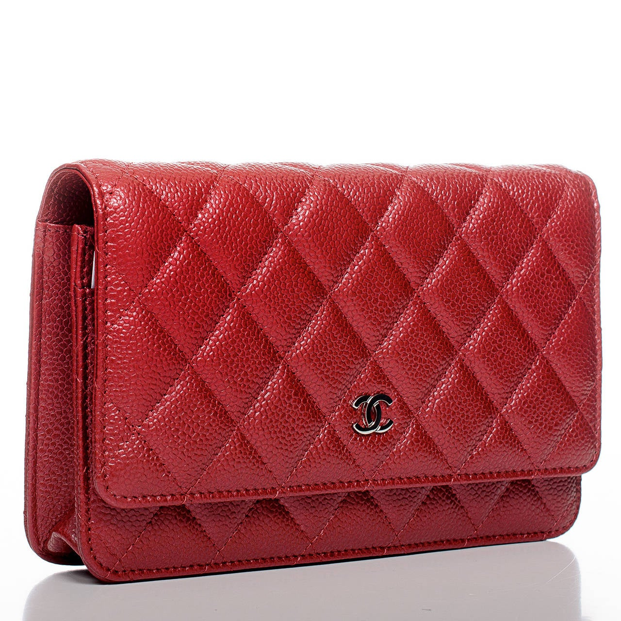 Chanel dark pink Classic Wallet On Chain (WOC) of quilted glazed caviar leather and silver tone hardware.