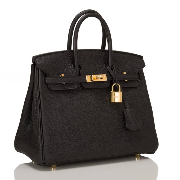 Hermes Black Birkin 25cm in togo leather with gold hardware.  This style features tonal stitching, front toggle closure, clochette with lock and two keys, and double rolled handles.  The interior is lined in Black chevre with one zip pocket with