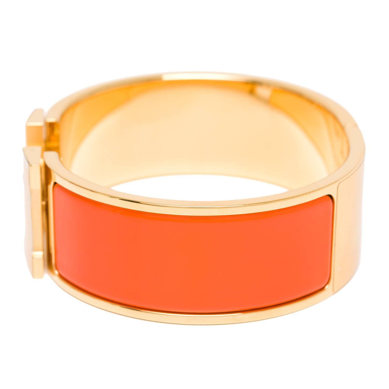 hermes clic clac h orange wide enamel bracelet pm at 1stdibs