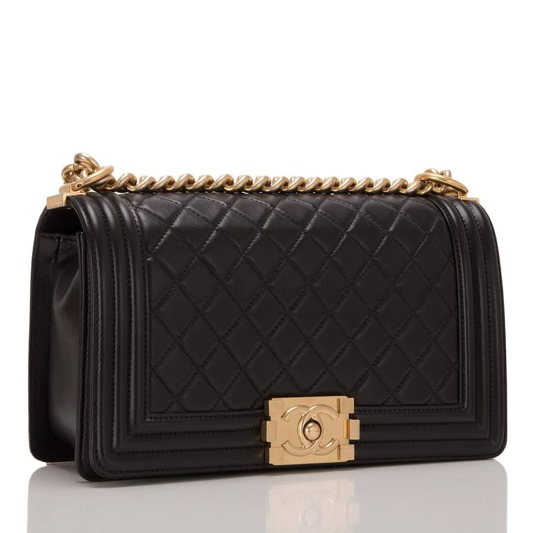 Chanel black quilted calfskin Medium Boy Bag with antique gold hardware.  This bag features a full front flap with Le Boy Chanel signature CC push lock closure and antique gold chain link and black leather padded shoulder/crossbody