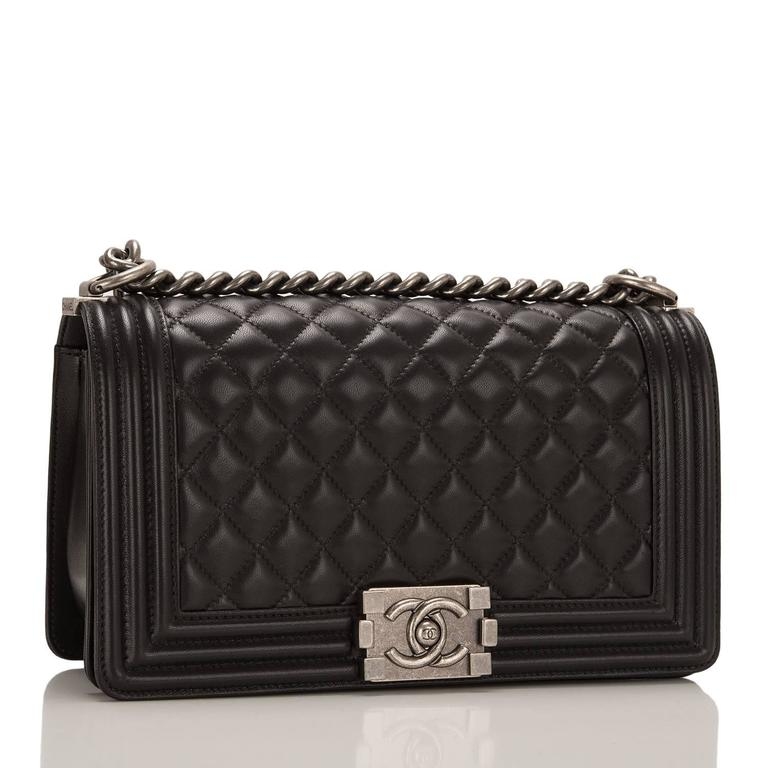 This Chanel Medium Boy bag is made of black lambskin leather and accented with aged ruthenium hardware.