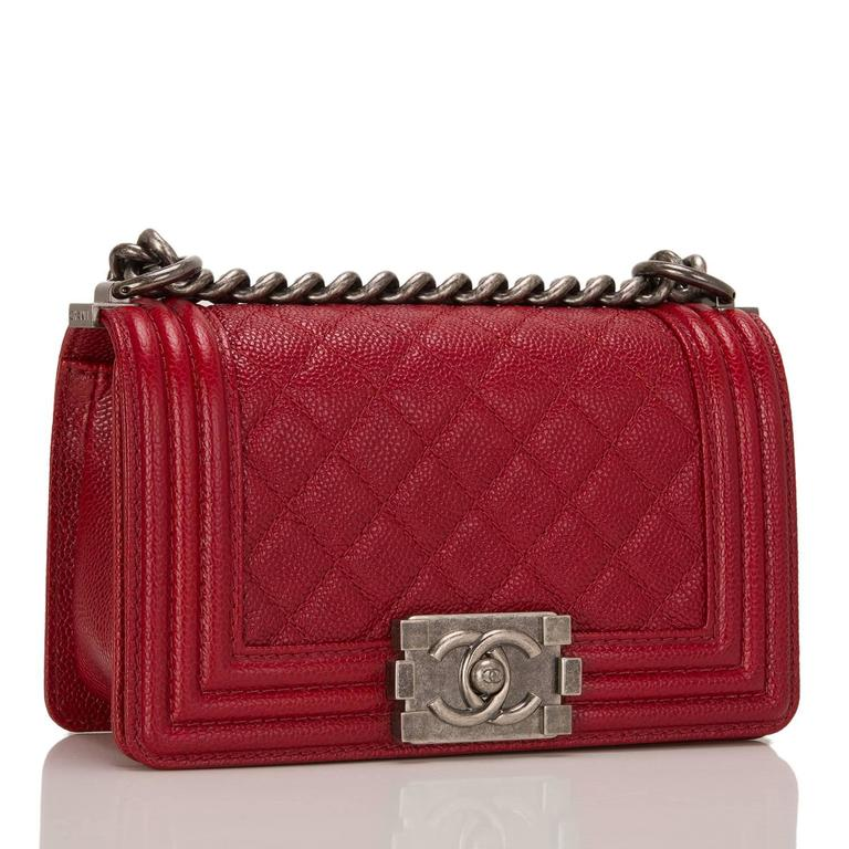 Chanel Small Boy bag in dark red caviar leather with aged ruthenium hardware.