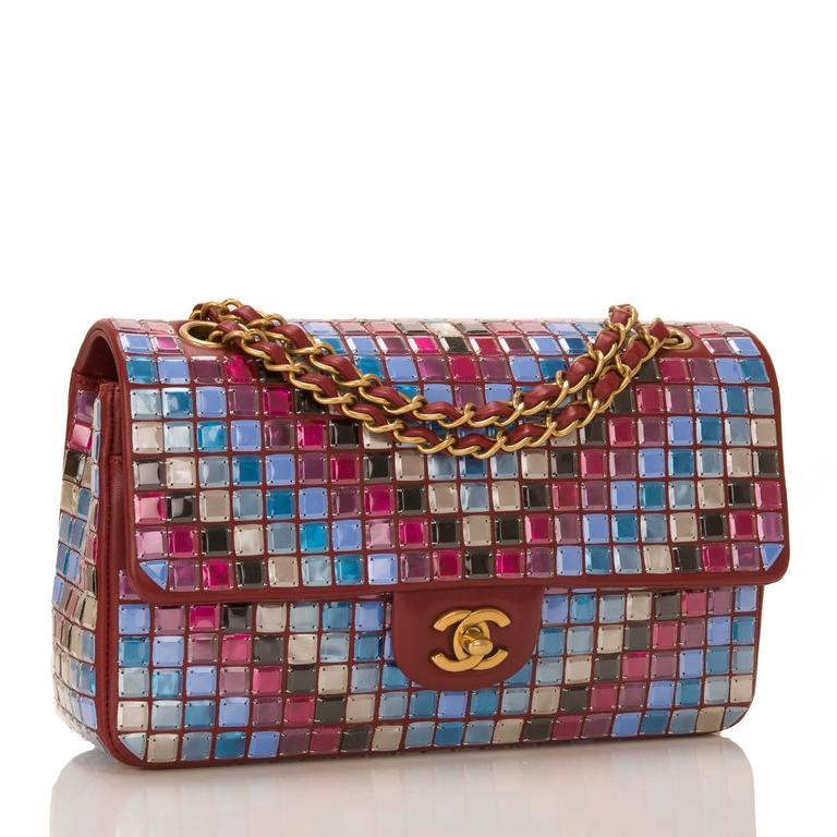Chanel runway Red Multicolor Lambskin Medium Flap Bag with Mosaic Embroideries by Lesage with gold tone hardware  The bag features allover mosaic embellishments of reds, pinks, blues, white, and black inn a diagonal pattern on red lambskin leather