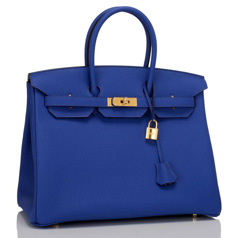 Hermes Blue Electric Birkin 35cm in togo leather with gold hardware.  This Birkin features tonal stitching, front toggle closure, clochette with lock and two keys, and double rolled handles. Interior is lined in Blue Electric chevre with one zip