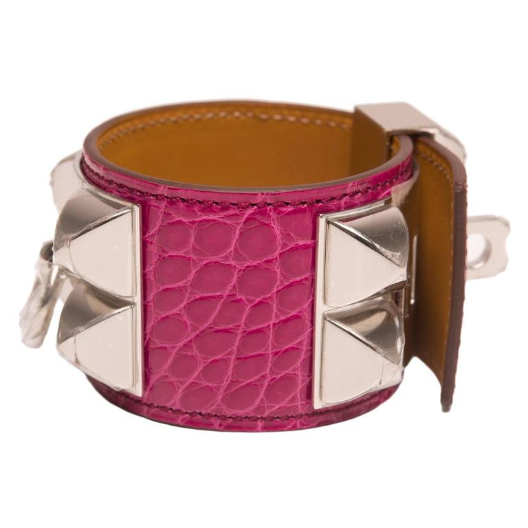 Hermes Limited Edition Collier de Chien (CDC) in Rose Scheherazade shiny alligator with palladium plated hardware in size small.  This style features palladium pyramid studs, center ring and adjustable push lock closure.  Origin: France  Condition: