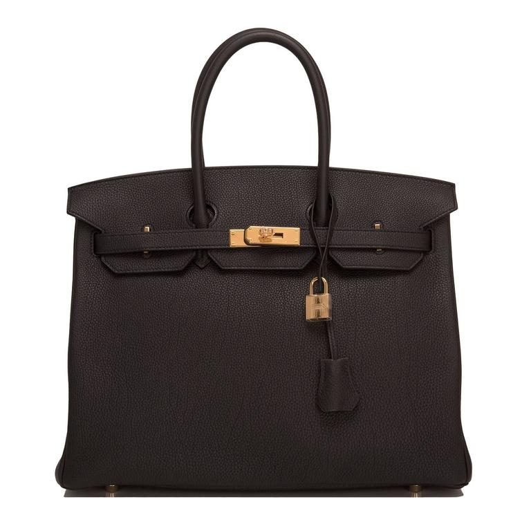 Hermes black Birkin 35cm in togo leather with gold hardware.  This Birkin features tonal stitching, front toggle closure, clochette with lock and two keys, and double rolled handles.  The Interior is lined in Black chevre with one zip pocket