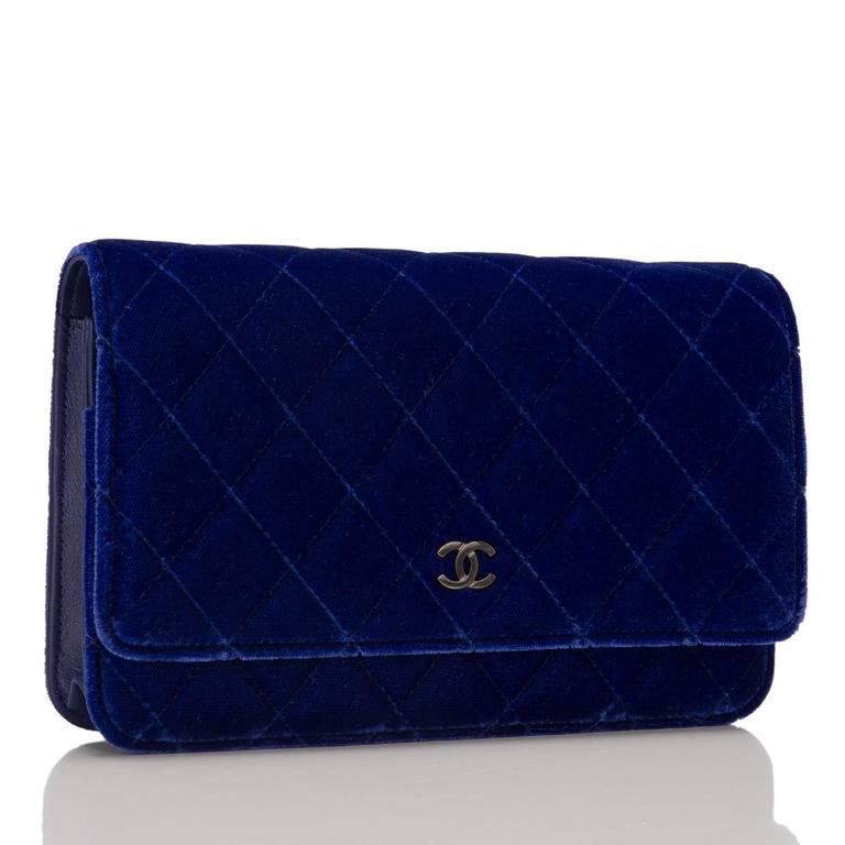Deep and vibrant, this electric blue velvet Wallet On Chain brings out the beauty of one of Chanel's classic WOC styles. It features signature Chanel quilting, front flap with CC charm and hidden snap closure, expandable sides and bottom, half moon