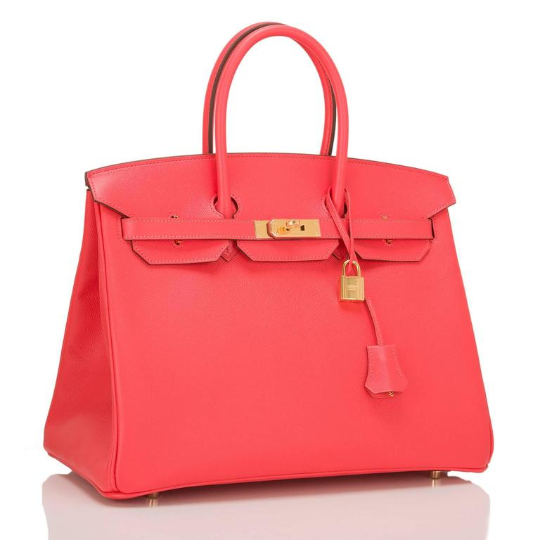This Hermes Rose Jaipur 35cm in epsom leather with gold hardware.  This Birkin features tonal stitching, front toggle closure, clochette with lock and two keys, and double rolled handles. The interior is lined in Rose Jaipur chevre with one zip