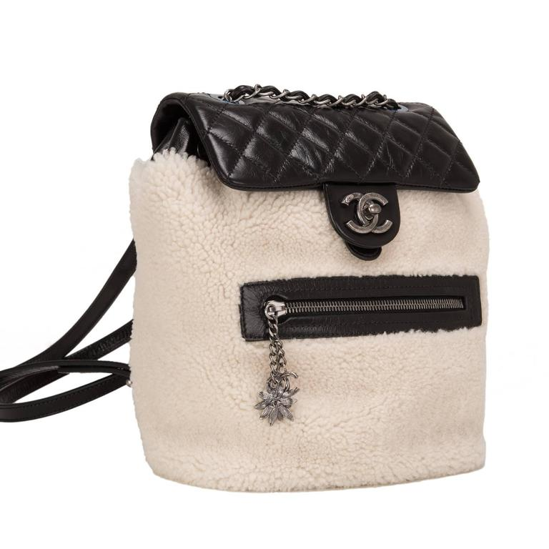 This Chanel limited edition Backpack Mountain Bag is made of cream shearing and black quilted calfskin leather and accented with aged ruthenium hardware.