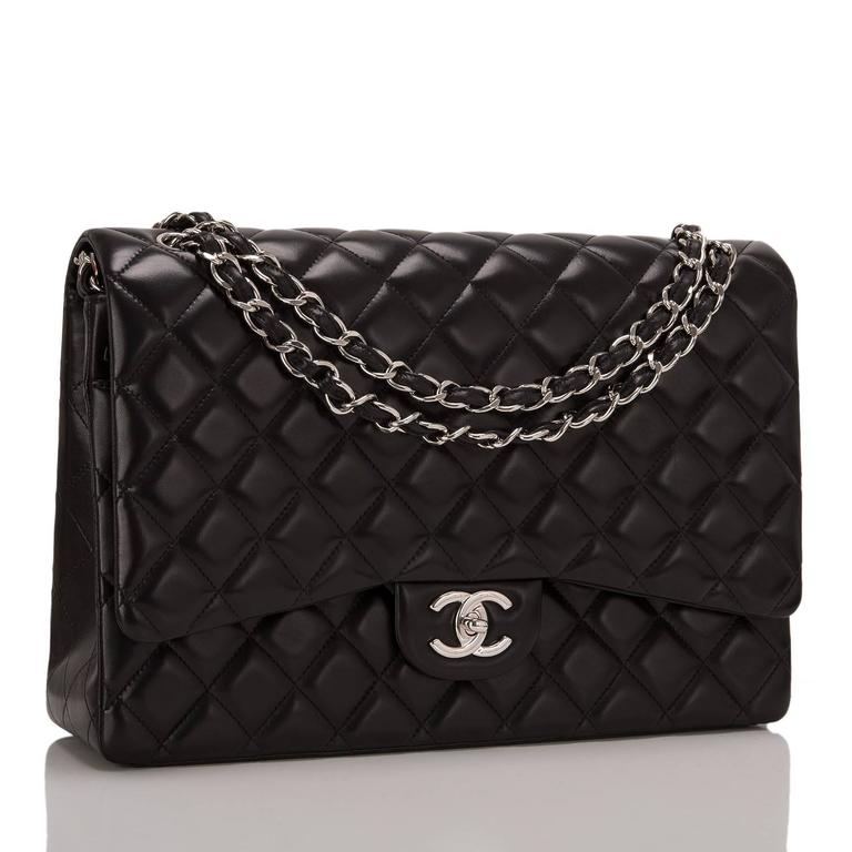 This Chanel Maxi Classic double flap bag is made of black lambskin leather and accented with silver tone hardware. The bag features a front flap with signature CC turnlock closure, a half moon back pocket, and an adjustable interwoven silver tone