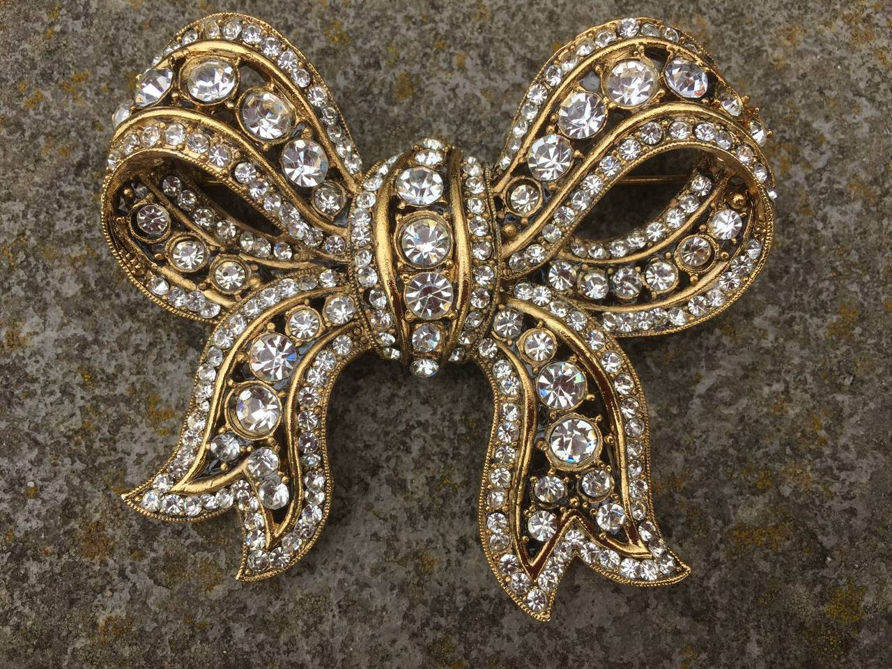 Serbin large gold and crystal bow brooch pin 1985 for sale at 1stdibs