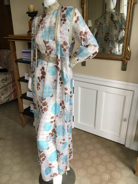 """Wonderful sheer three piece evening dress / caftan from Adolfo circa 1977. There is a dress, sleeveless vest and matching belt. Bust 38"""" Waist 42"""" Hips 44"""" Length 57"""" Excellent condition"""