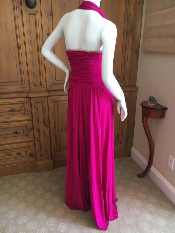 "Exquisite fucsia evening dress from Giambattista Valli . Low cut halter dress in a wonderful shade of deep pink. Size XS Bust 32"" Waist 24"" Hips 39"" Length 64"" Excellent condition"
