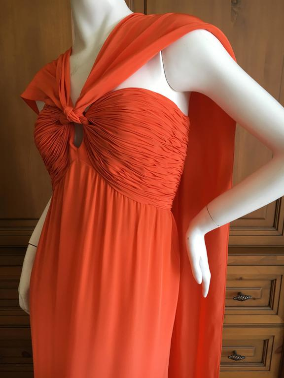 """Oscar de la Renta Tangerine Strapless Evening Dress with Detachable Scarf Cape. Beautifully made with an inner corset. The long flowing scarves detach from the bust, you can wear it with or with out. New with Tag's Size 10 Bust 40"""""""