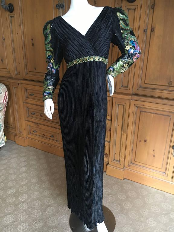"Mary McFadden  Couture Low Cut Black Plisse Pleated Dress w Beaded Sleeves Size 6 Bust 38"" Waist 29"" Hips 48"" Length 61"" Excellent condition"