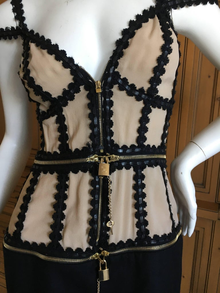 Alexander McQueen Rare Zip Apart Transformer Dress with All Locks & Keys. This is pre death McQueen, and very rare to find with all the locks and keys intact. This zips apart in to three separate pieces, fastened together with working locks &