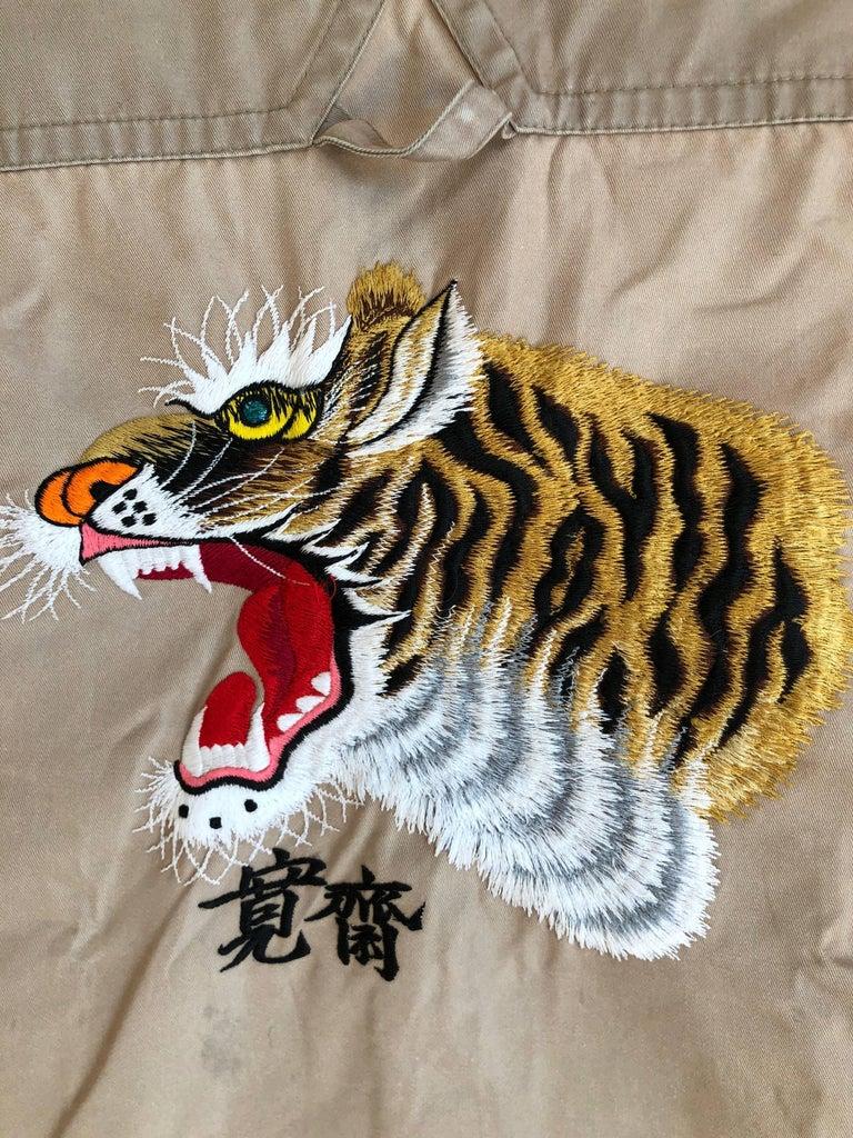Kansai Yamamoto Khaki Men's Military Shirt with Tiger Embroidery. Join the Kansai Army. A predecessor of designers like Issey Miyake, Yohji Yamamoto, Kenzo Takada, and Rei Kawakubo, Kansai Yamamoto was the first Japanese designer to show in London