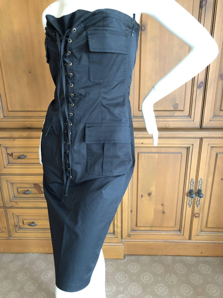 "Yves Saint Laurent by Tom Ford Strapless Black Safari Dress with Corset Lacing . Cotton with a touch of spandex Size 38 Bust 36"" Waist 28"" Hips 39"" Length 33"" Excellent condition"