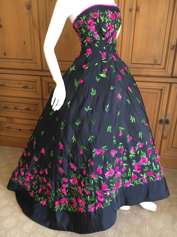 "Oscar de la Renta exquisite black ball gown with floral embellishments. Interior has multiple layers of tulle petticoats , this has the form of an 1860's ball gown. Size 0 Bust 32"" Waist 25"" Hips 40"" Length 56"" Excellent condition"