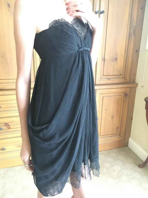 "Exquisite little black dress from Oscar de la Renta for Bergdorf Goodman. Strapless with a sweetheart bustling, trimmed in lace, this has a full corset interior. Size 2 Bust 34"" Was it 26"" Hips 46"" Length 32"" Excellent condition"